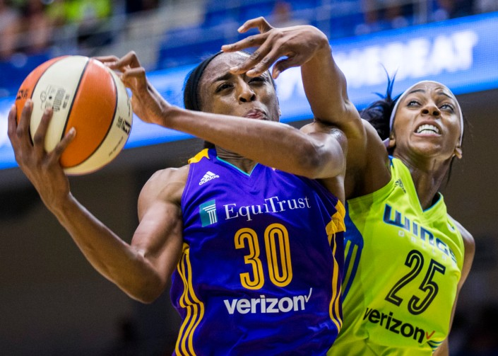 Dallas Wings forward Glory Johnson (25) blocks the shot of Los Angeles Sparks forward Nneka Ogwumike (30) during the first quarter of their WNBA basketball game, Saturday, June 11, 2016 in Arlington, Texas. (Ashley Landis/The Dallas Morning News via AP) -- MANDATORY CREDIT, TV OUT, MAGS OUT, NO SALES, INTERNET USE BY AP MEMBERS ONLY